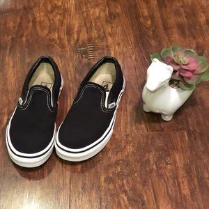 Vans black with white sole slip on sneakers